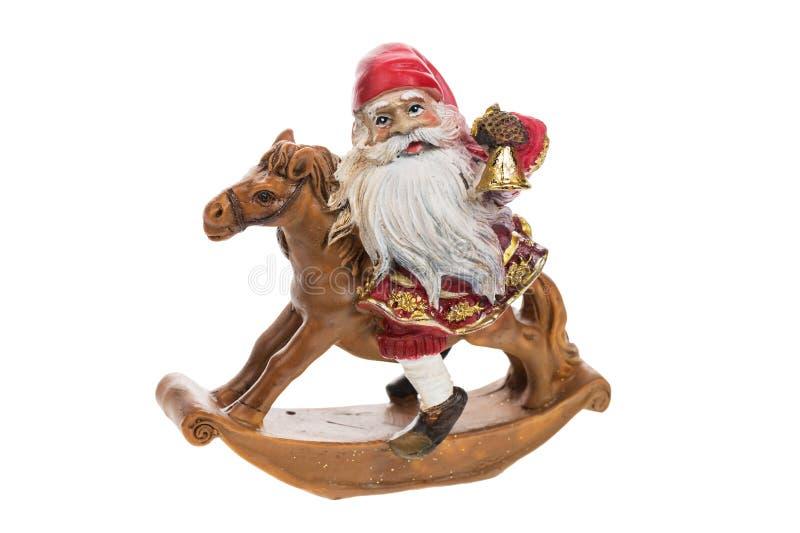 Cavalo decorativo do brinquedo com fim de Santa Claus isolado acima no fundo branco fotografia de stock royalty free