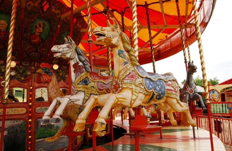 Cavalos do recinto de diversão fotos de stock royalty free