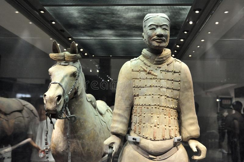 Cavalryman with his saddled war-horse. The terracotta soldier and his horse in the mausoleum of the first Qin Emperor in China stock photography