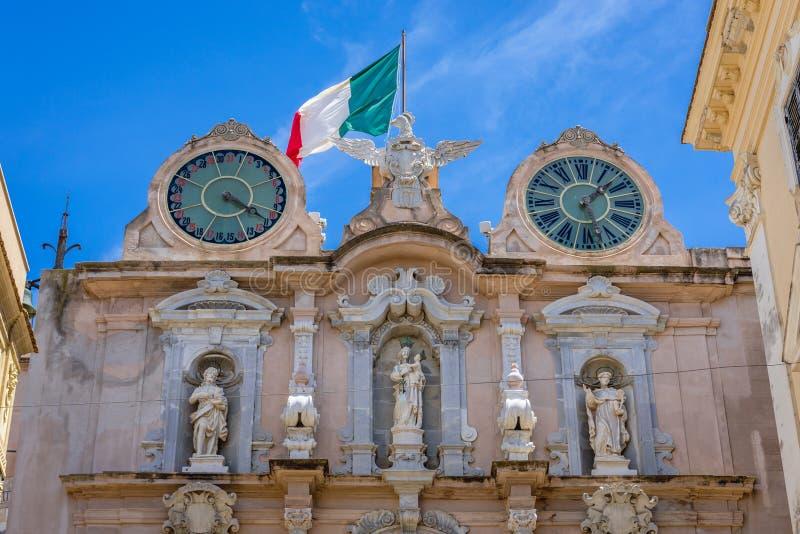 Cavarretta Palace in Trapani city. Close up on facade of Cavarretta palace in Trapani, capital of Trapani Province on Sicily Island in Italy, palazzo, clock royalty free stock photos