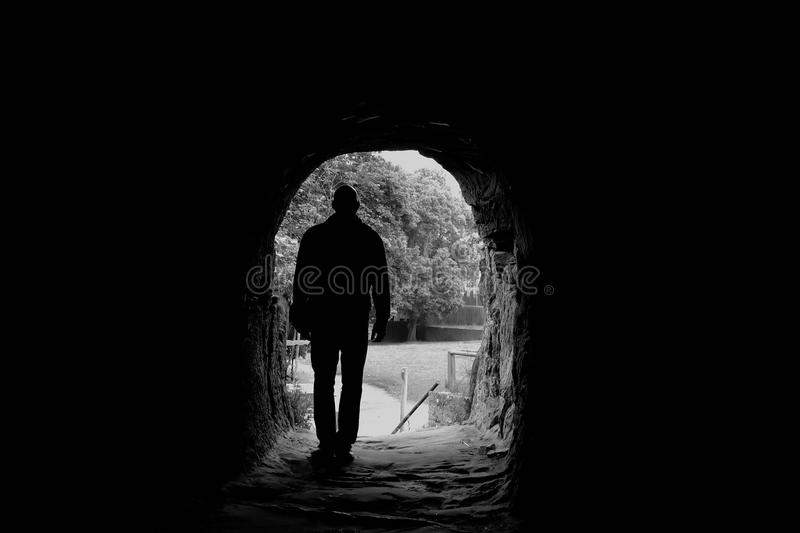 Cave. A man goes through a cave royalty free stock photography