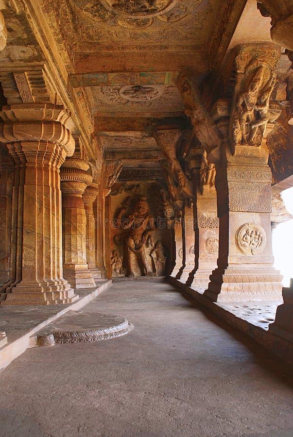 Badami Caves, Karnataka, India. Cave 3 : Carved figure of Vishnu as Narasimha, half human, half lion. Brackets of pillars, has car. Cave 3 : Carved figure of royalty free stock photos