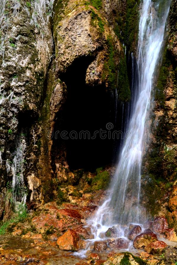 Cave entrance. Stalactite cave in the mountains of the North Caucasus, Russia stock photo