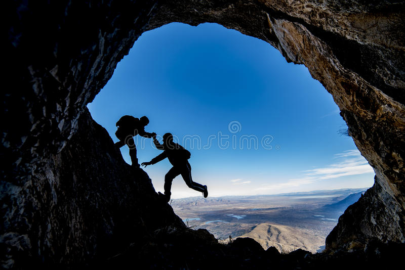 Cave exploration adventure. Crazy adventurous and climber.Discovery and adventure royalty free stock photos