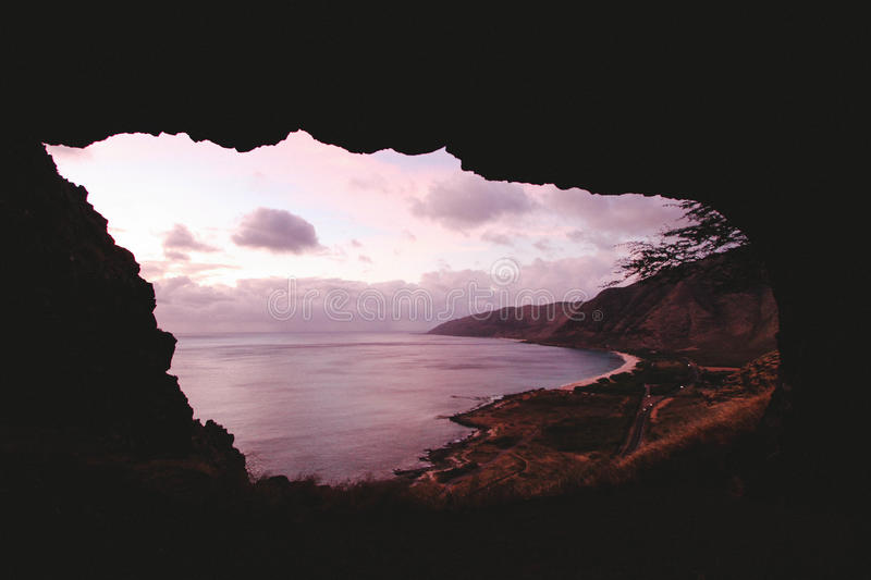 Download Cave On Foreground By The Seashore Stock Photo - Image of free, dusk: 82949994