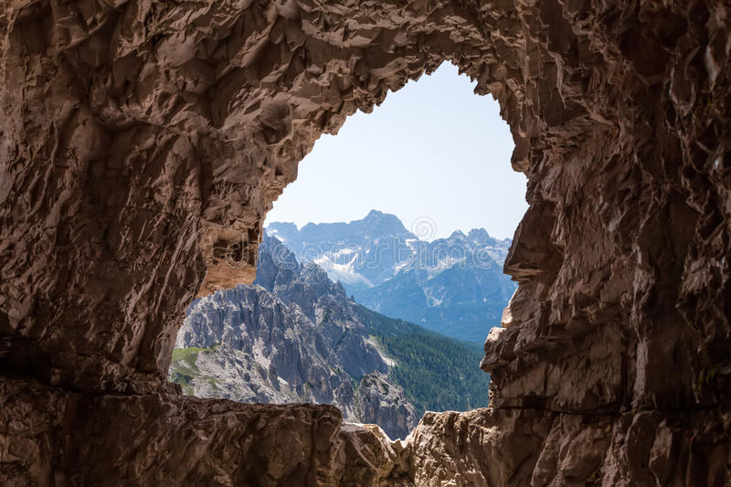 The cave in the mountains stock photos