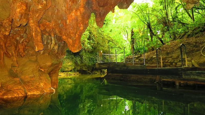 Cave in New Zealand. With underground water royalty free stock photography