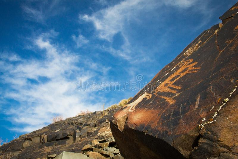 Cave painting. Petroglyphs of Ungurthas. Central Asia royalty free stock photo