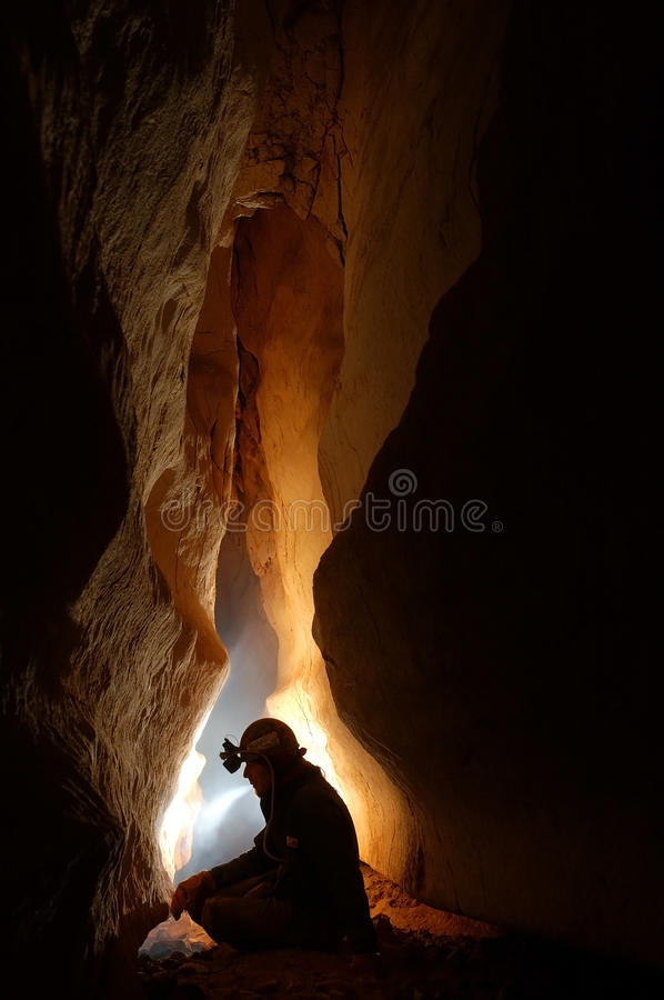 Cave passage with a caver royalty free stock images