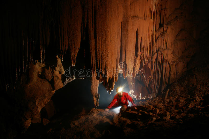 Cave passage with a caver royalty free stock image
