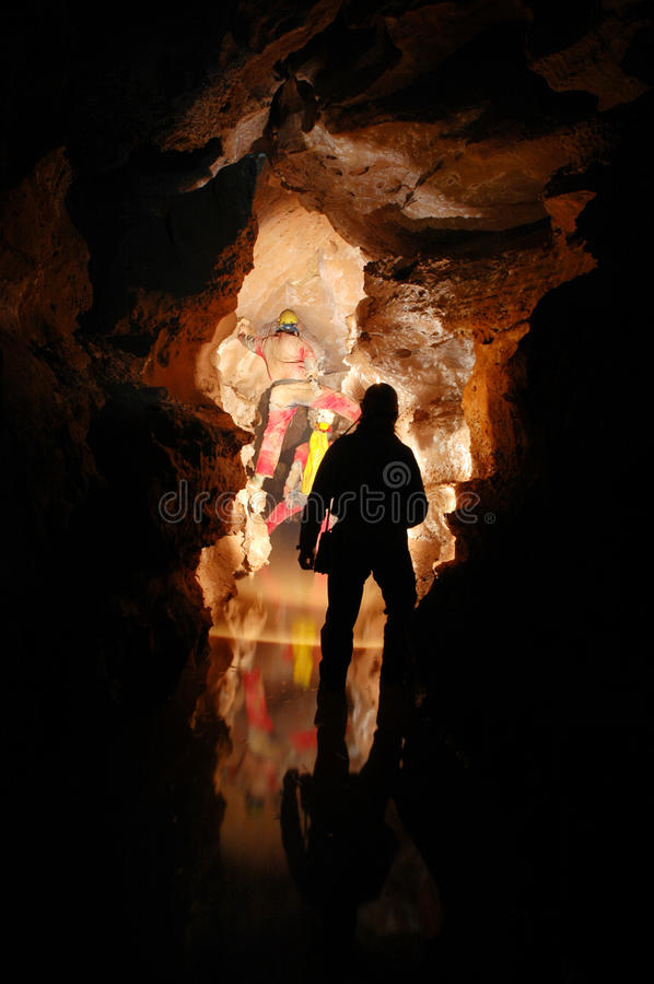 Download Cave passage with cavers stock photo. Image of dark, interior - 15352362