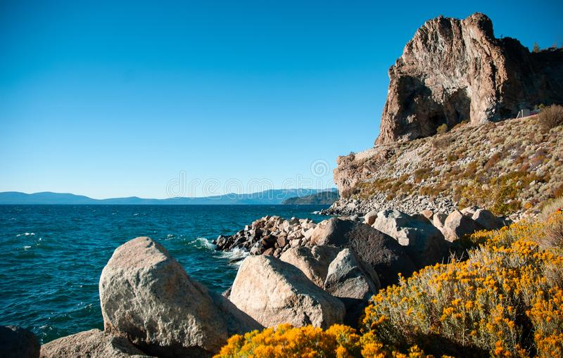 Cave rock and yellow sagebush of Lake Tahoe in Summer, Navada, U stock photos