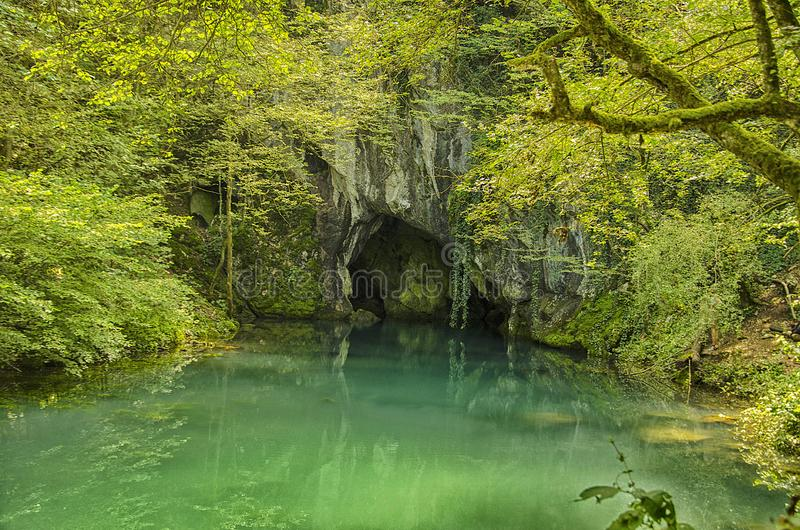 From the cave springs the river stock photography