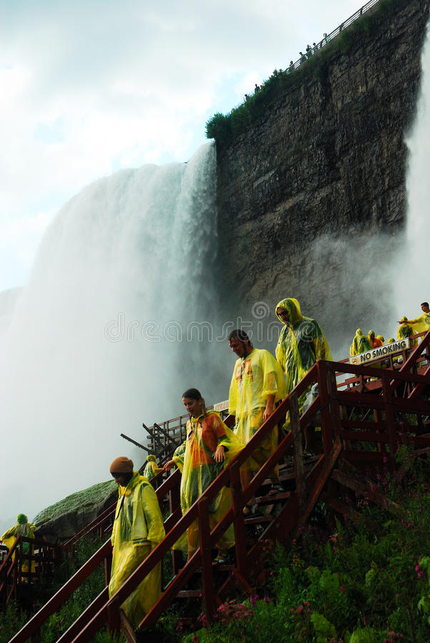 Cave of the Winds Tour. Visitors descend from the Cave of the Winds Tour at the base of the American Falls in Niagara Falls royalty free stock photos