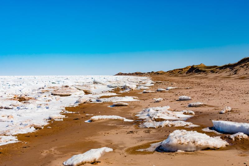Cavendish Beach Prince Edward Island NP Canada. Frozen north Atlantic ocean pack ice off Cavendish Beach in Prince Edward Island National Park, PEI, Canada royalty free stock photo