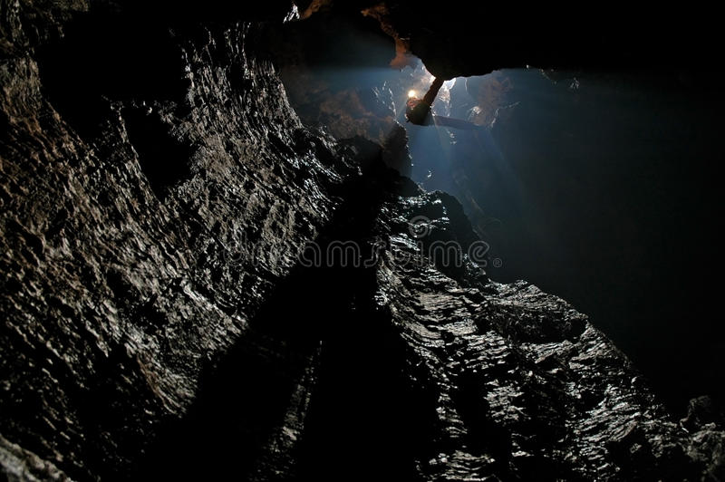 Caver abseiling in a pothole royalty free stock image