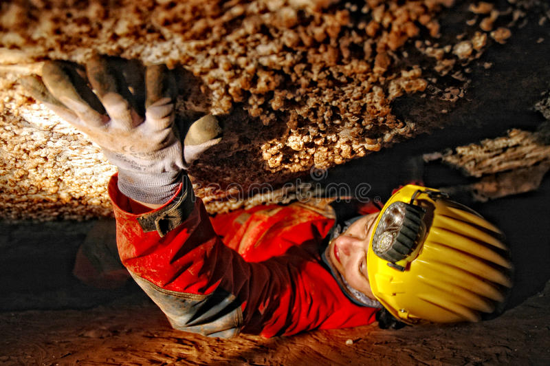 Caver in a narrow passage royalty free stock photo