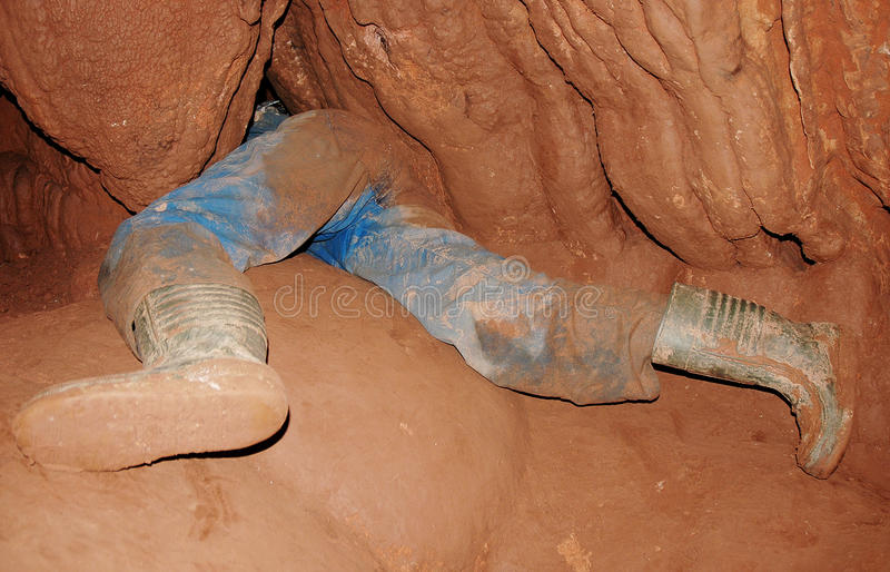 Caver in a narrow passage royalty free stock images