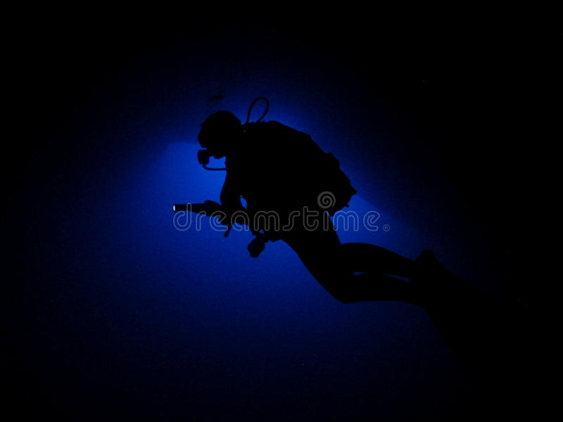 Cavern diver silhoutte stock photography