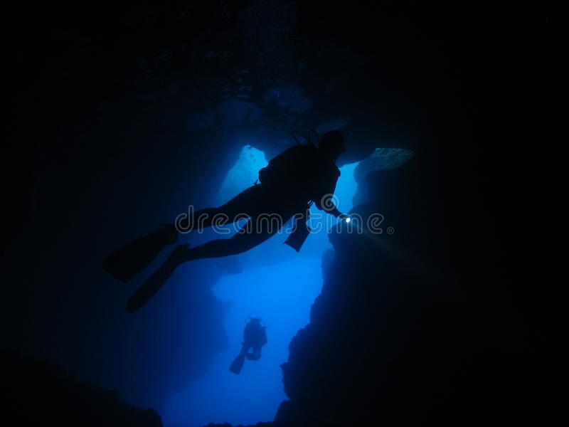 Cavern diver silhoutte royalty free stock photo