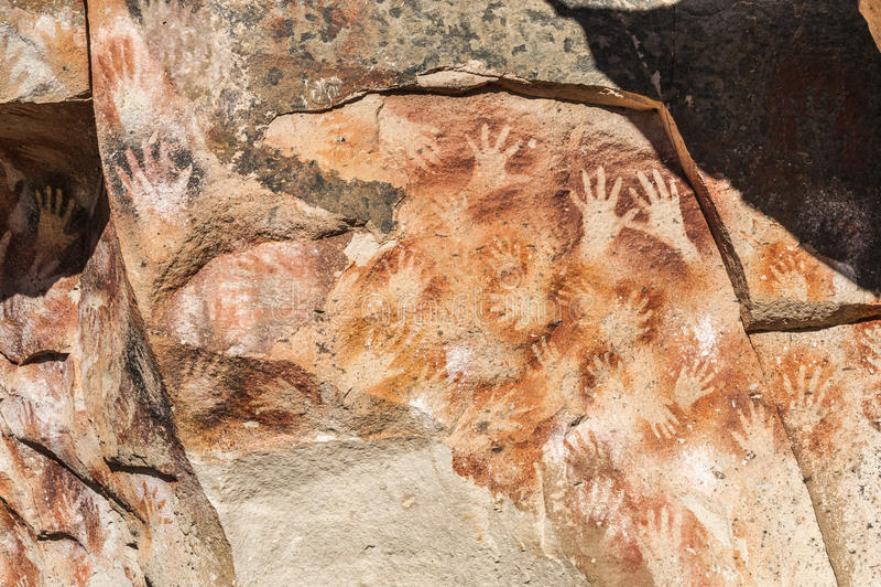 Caverne des mains - peintures des personnes antiques, Argentine photos stock