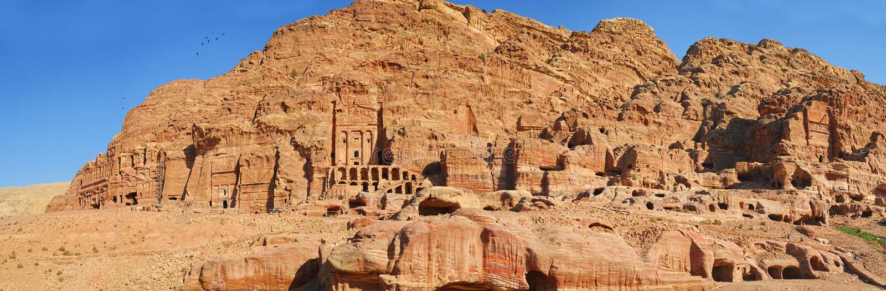 Caves in lost city of world wonder Petra, Jordan stock image