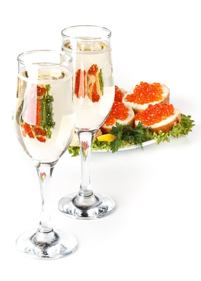 Caviar et champagne rouges photos libres de droits