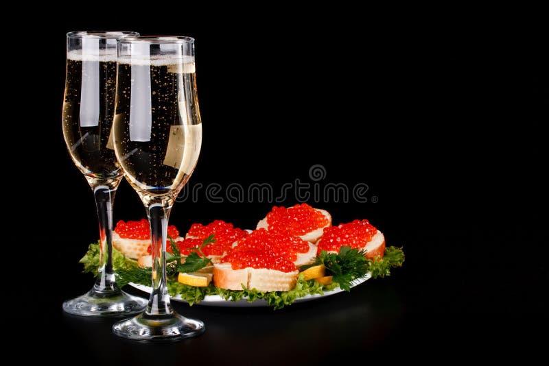 Caviar y champán rojos fotografía de archivo libre de regalías