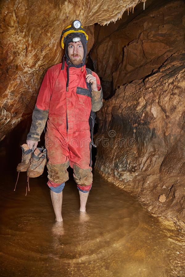 Caving barefoot in water stock photos