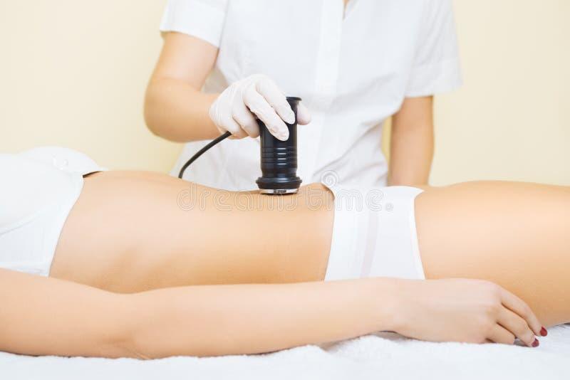 Cavitation treatment. Young woman at cavitation treatment