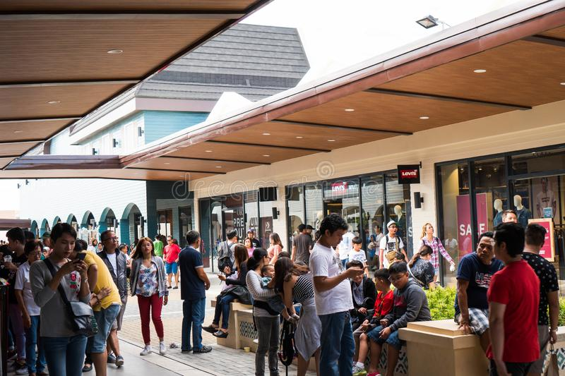 A busy Designer Outlet at Cavite, Philippines. Cavite, Philippines - November 30, 2018: a busy Designer Outlet at Cavite, Philippines stock images