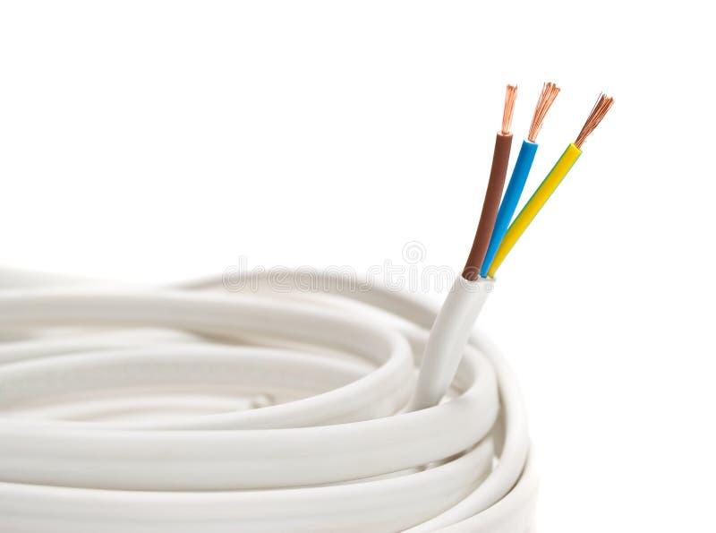 Cavo elettrico su priorità bassa bianca immagini stock