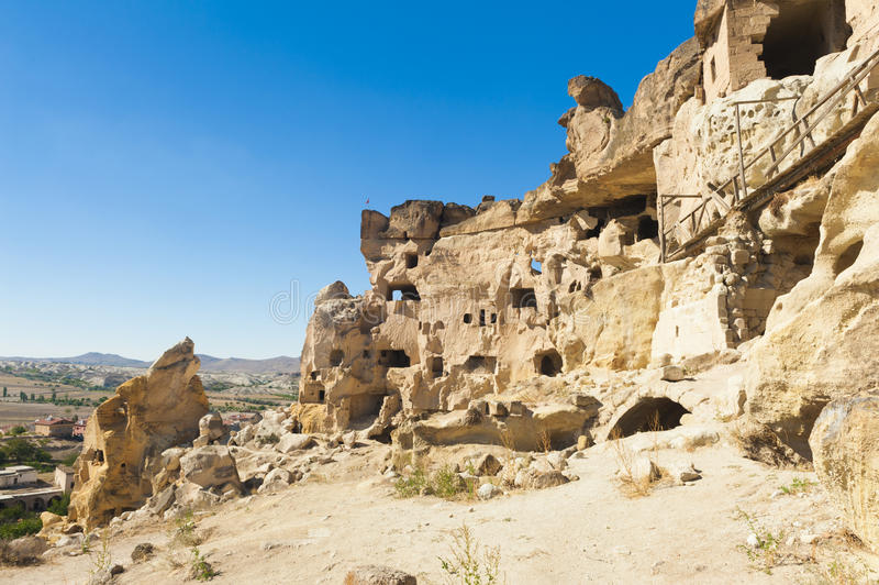 Cavusin. Detail of the ancient castle of Cavusin dug from a mountains, Cappadocia, Turkey royalty free stock photo