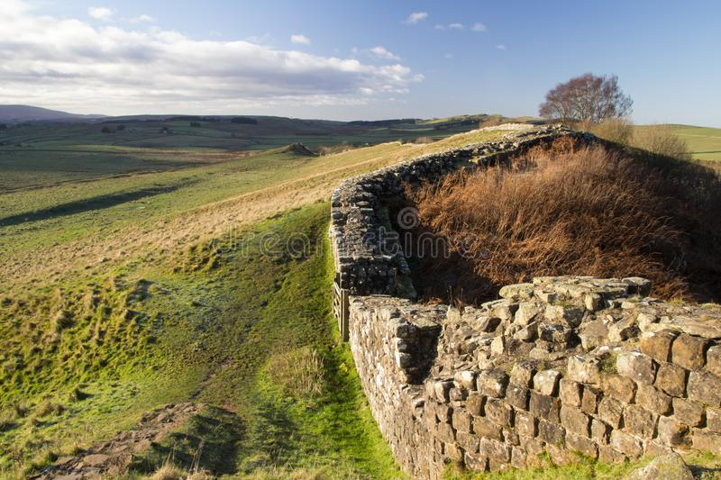Cawfields, Hadrian`s Wall, Northumberland, Uk. The roman wall at Cawfields crags near Haltwhistle in Northumberland UK, is a World Heritage site stock photography