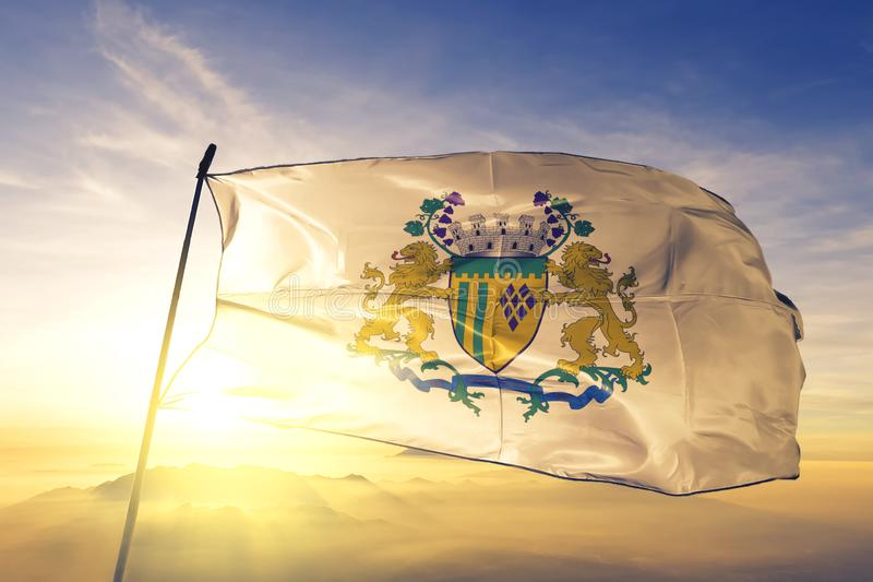 Caxias do Sul of Brazil flag waving on the top sunrise mist fog. Caxias do Sul of Brazil flag textile cloth fabric waving on the top sunrise mist fog stock images