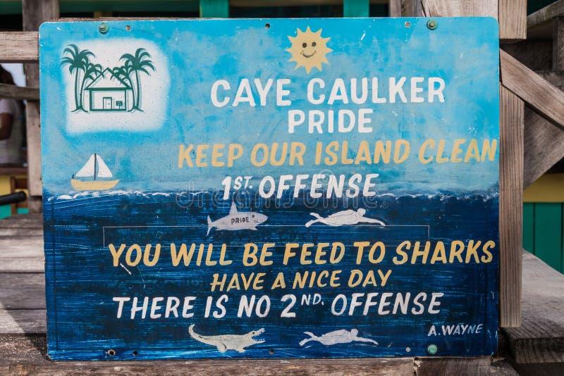 CAYE CAULKER, BELIZE - MARCH 2, 2016: Painted slogan promoting cleanliness in Caye Caulker village, Beli. Ze stock image