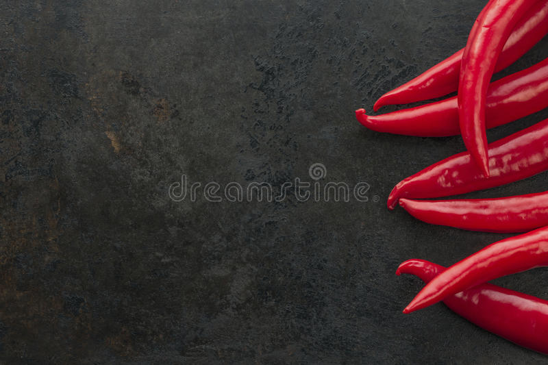 Cayenne chilli peppers on rusty metal background royalty free stock photos