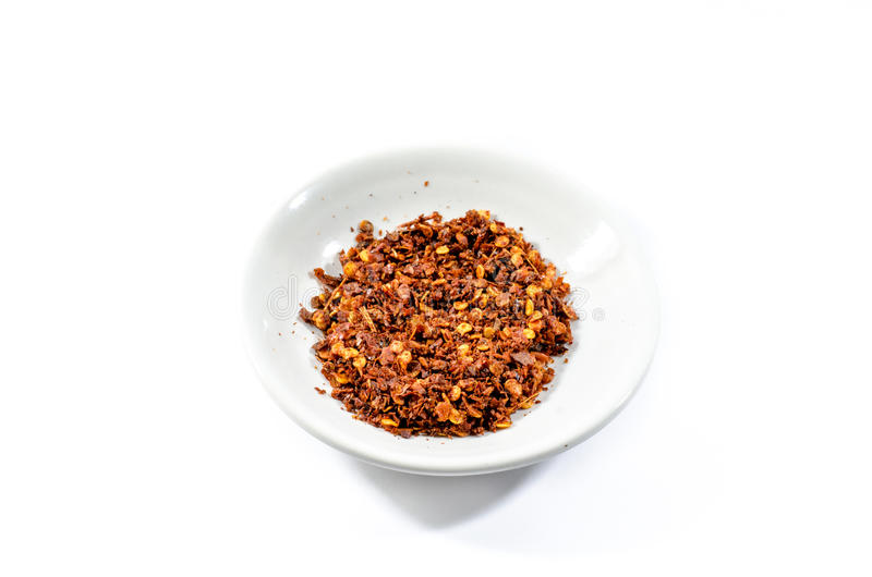 Cayenne pepper and chilli pepper in bowl on white background stock photography