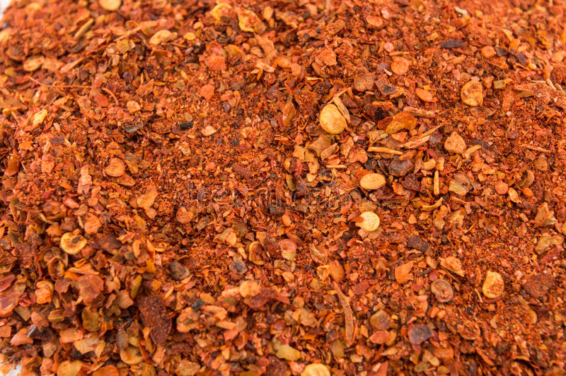 Cayenne pepper and dried peppers. Ground red pepper and dried peppers closeup royalty free stock images