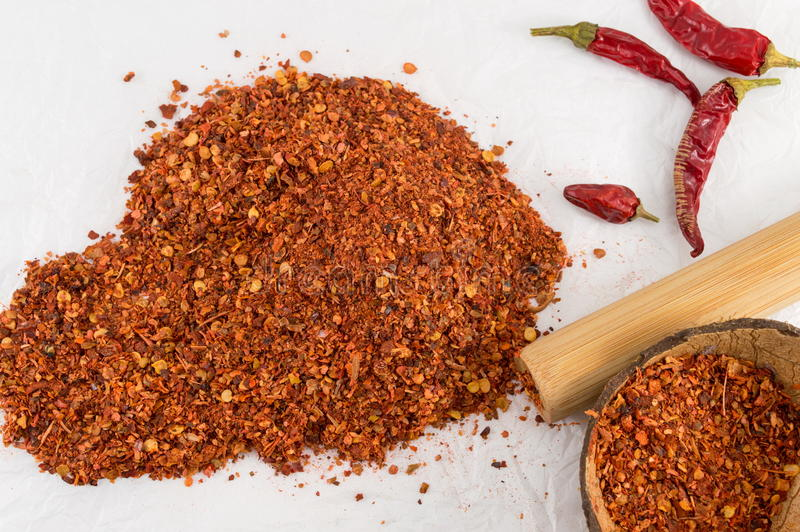 Cayenne pepper and dried peppers. Ground red pepper and dried peppers closeup royalty free stock photography
