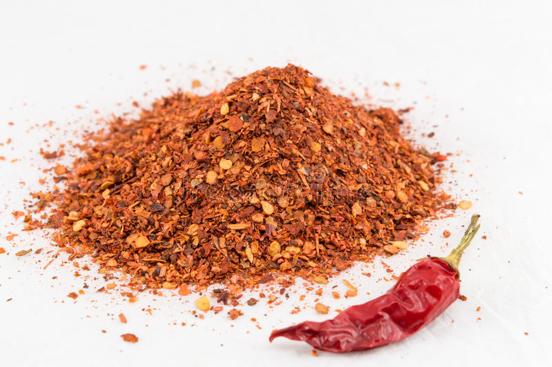Cayenne pepper and dried peppers. Ground red pepper and dried peppers closeup stock photo