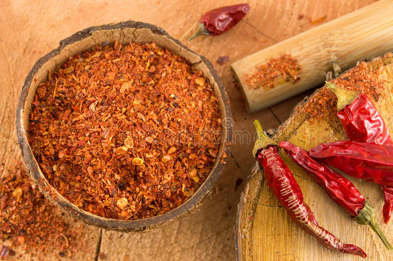 Cayenne pepper and dried peppers. Ground red pepper and dried peppers closeup stock photos