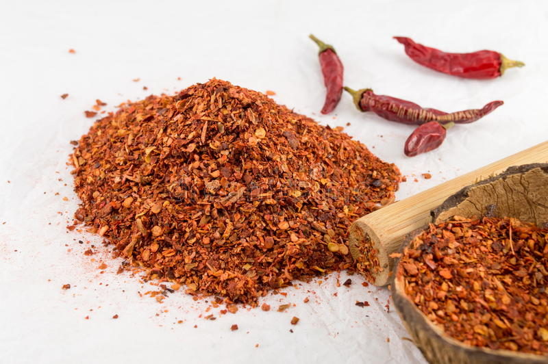 Cayenne pepper and dried peppers. Ground red pepper and dried peppers closeup stock image
