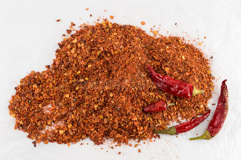 Cayenne pepper and dried peppers. Ground red pepper and dried peppers closeup stock photography