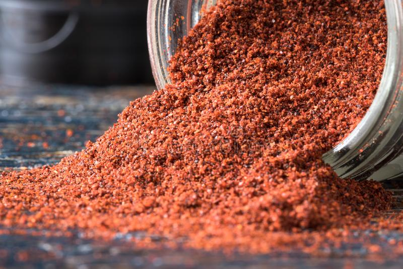 Cayenne Pepper. Ground cayenne pepper spilled from a spice jar stock photography