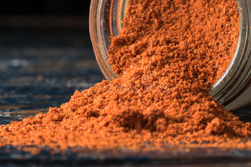 Cayenne Pepper Spilled from a Spice Jar. Close up view of ground cayenne pepper spilled from a spice jar stock photography