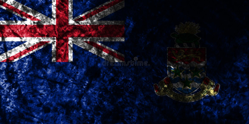 Caymanöarna grungeflagga på den gamla smutsiga väggen, beroende territorium flagga för brittiska utländska territorier, Britannie royaltyfri illustrationer