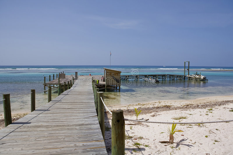 Cayman Island Dock and Boats. Cayman Island Dock and Dive Boats with Aqua Blue Water royalty free stock photography