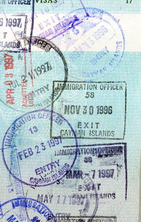 Cayman Islands passstämplar royaltyfri fotografi