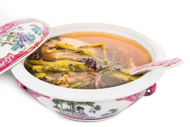 Cazuela de la sopa china del berro aislada en blanco fotografía de archivo